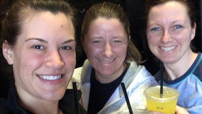Jessica Dodge, left, Jodi Weitz and Kim Kedinger enjoy a strawberry mango Spark beverages from Uba Coffee Hub recently.