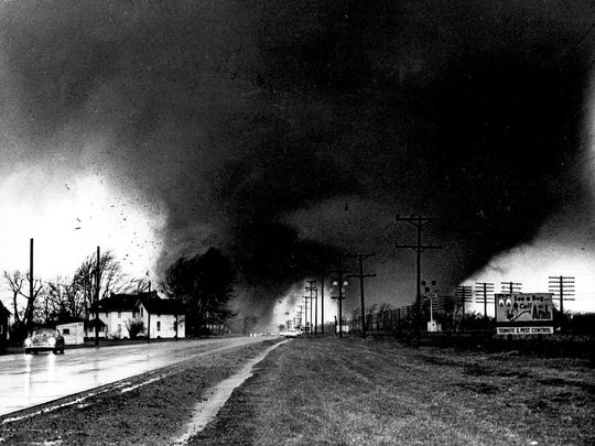 Twin tornado funnel clouds sweep along U.S. 33 near Dunlap, Ind., April 11, 1965. The Palm Sunday disaster that struck the Midwest that day injured at least 5,000 persons and killed 270 others.   (AP Photo/Elkhart Truth, Paul Huffman)