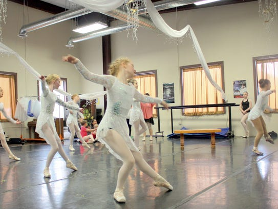 "Dancers rehearse their parts as horses in ""Twisted Tales."""