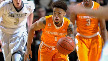 Tennessee guard Lamonte Turner (1) pushes the ball up the court in the first half Saturday night.