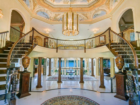 There are two sets of sweeping marble staircases.