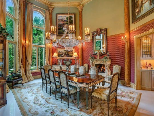 The dining room has floor-to-ceiling windows.