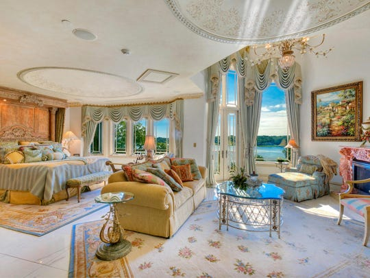 The master bedroom has marble floors and a fireplace.