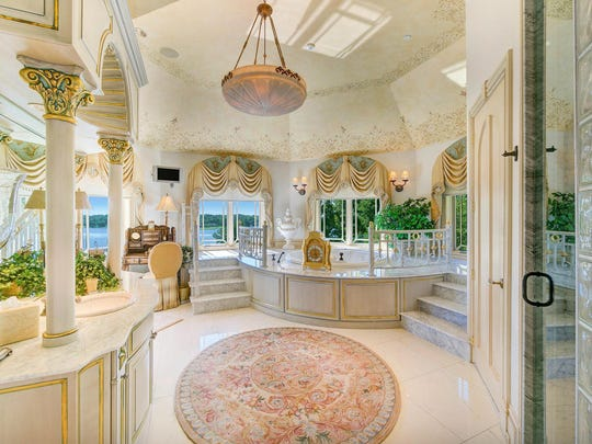 The marble master bath has a bidet, double sinks and a fireplace.