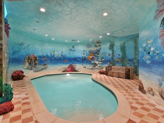 The mansion has both indoor and outdoor pools.