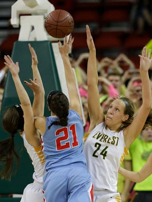 D.C. Everest's Taylor Hodell (right) defends Arrowhead's Grace Gilmore during Friday's WIAA Division 1 girls' state basketball semifinal game at the Resch Center in Ashwaubenon.