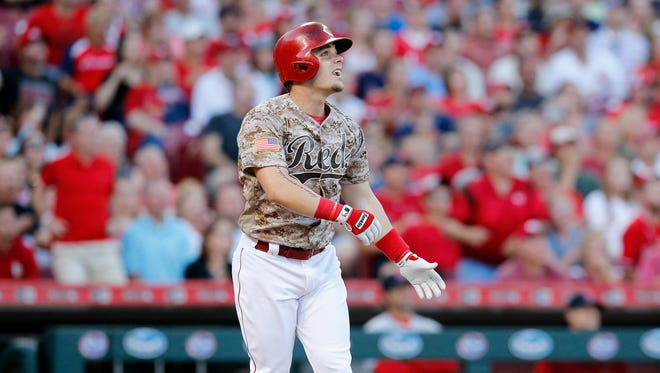 Cincinnati Reds left fielder Scooter Gennett (4) watches as he hits a grand slam home run to right-center field in the bottom of the third inning against the St. Louis Cardinals at Great American Ball Park on June 6, 2017.