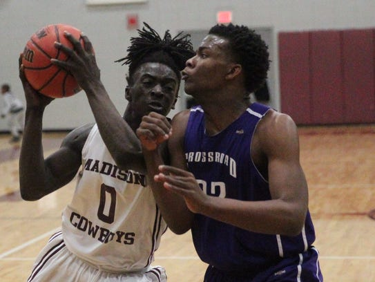 Madison County's Travis Jay drives to the basket during