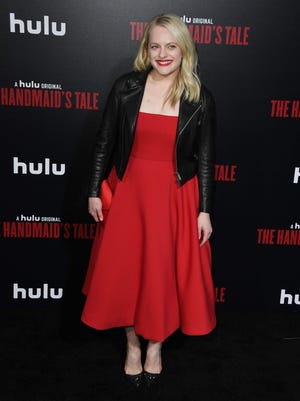Elisabeth Moss arrives for the season 2 premiere of Hulu's 'The Handmaid's Tale' at the TCL Chinese Theatre in Hollywood.