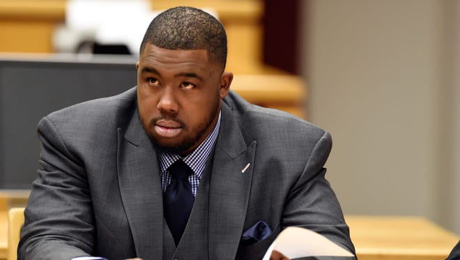 Detroit Lions defensive tackle Nick Fairley reviews court documents as he awaits jury selection for the start of his 2012 DUI and reckless driving case at Mobile Government Plaza.