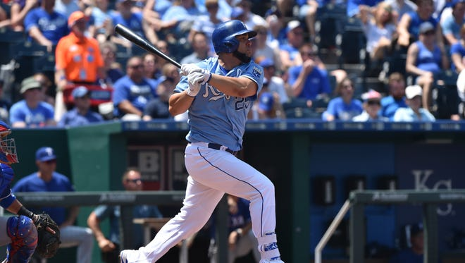 Kendrys Morales hits an RBI double during the Royals' win over the Texas Rangers on Sunday.