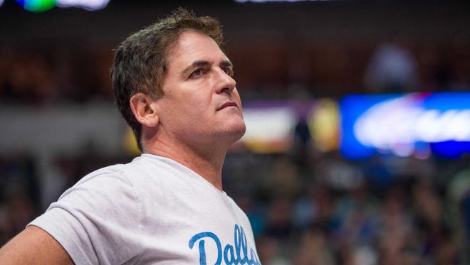 Dallas Mavericks owner Mark Cuban watches the game between the Dallas Mavericks and the Phoenix Suns at the American Airlines Center. The Mavericks defeated the Suns 107-104.
