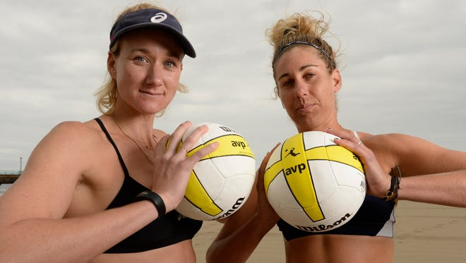 Kerri Jennings Walsh, left, and April Ross on the sand at Manhattan Beach, Calif.