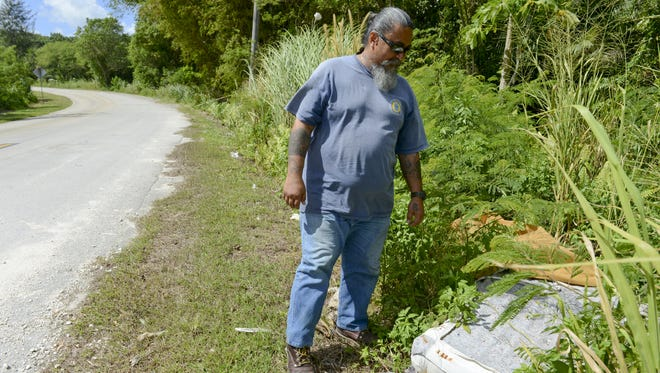 In this file photo, Steve Cruz, field supervisor with the Chalan Pago-Ordot mayor's office, shows a spot where an old mattress was discarded near the former Ordot dump on Jan. 18. The road, and other areas in the village, are often marred by illegal dumping, he said. Cruz said the mayor's staff make weekly trips to the Layon landfill in Inarajan to discard up to 10 illegally dumped mattresses.