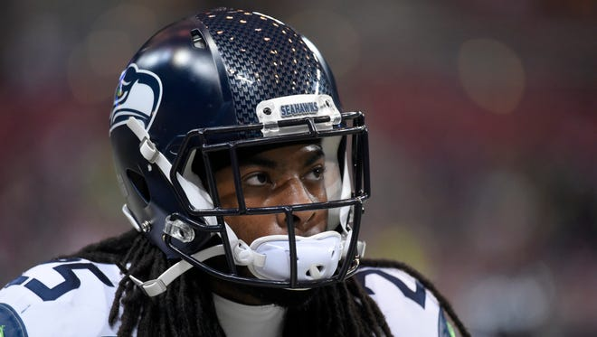 Seattle Seahawks cornerback Richard Sherman warms up before the start of an NFL football game between the St. Louis Rams and the Seattle Seahawks Sunday, Sept. 13, 2015, in St. Louis.