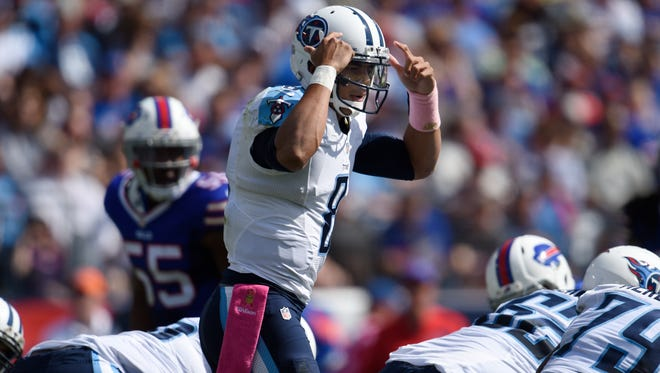 Titans quarterback Marcus Mariota (8) calls a play at the line in the first half at Nissan Stadium on Sunday Oct. 11, 2015, in Nashville, Tenn.