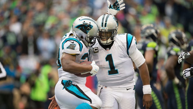 Oct 18, 2015: Carolina Panthers running back Jonathan Stewart (28) celebrates with quarterback Cam Newton (1) after scoring a touchdown during the second half against the Seattle Seahawks at CenturyLink Field. The Panthers won 27-23.