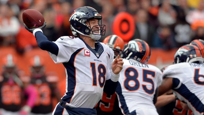 Oct 18, 2015: Denver Broncos quarterback Peyton Manning (18) throws a pass during the second half against the Cleveland Browns at FirstEnergy Stadium. The Broncos won 26-23.