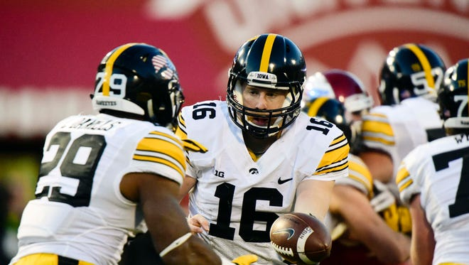 Iowa Hawkeyes quarterback C.J. Beathard (16) hands the ball off to running back LeShun Daniels Jr. (29) against the Indiana Hoosiers during the second half at Memorial Stadium. The Hawkeyes won 35-27.