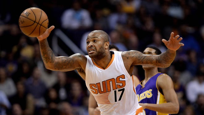 Nov 16, 2015: Phoenix Suns forward P.J. Tucker (17) lounges for the basketball in first half of the NBA game against the Los Angeles Lakers at Talking Stick Resort Arena.