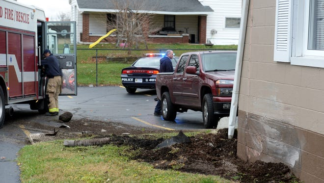 Richmond police officers and firefighters respond to an accident Tuesday on South Ninth Street.