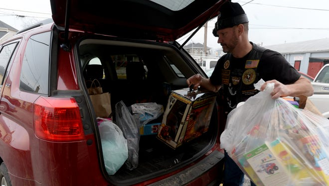 Ron Ross unloads toys for the Toys for Tots program at the Marine Corps League in Richmond.
