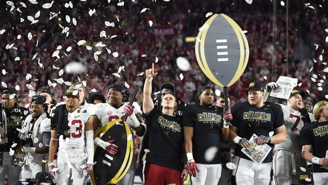 Alabama Crimson Tide players celebrate after defeating the Clemson Tigers in the 2016 CFP championship.