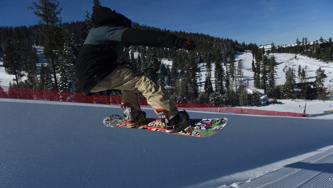 A snowboarder rides the half-pipe at Northstar California, one of three resorts in the Lake Tahoe area operated by Vail Resorts, Inc.
