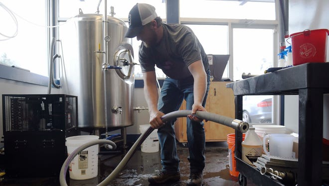Co-owner Jared Welch cleans up after brewing at the new Southern Grist brewery in East Nashville.