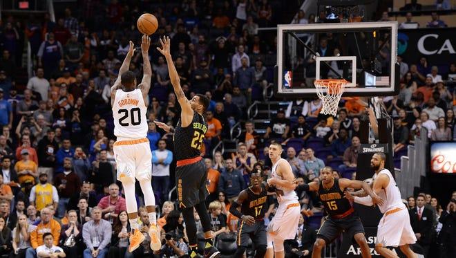 Jan 23, 2016: Phoenix Suns guard Archie Goodwin (20) makes the game winning three point basket against Atlanta Hawks forward Thabo Sefolosha (25) in the second half at Talking Stick Resort Arena. The Suns won 98-95.