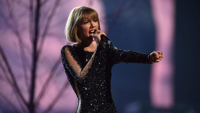 Taylor Swift opens the 58th Grammy Awards with 'Out of the Woods.'