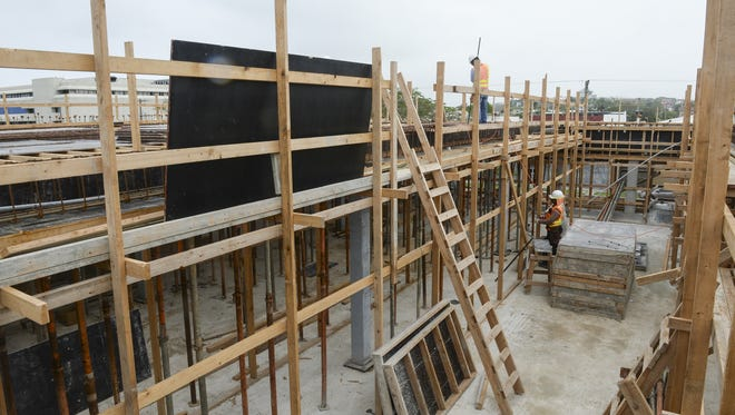 Workers continue construction on a two-story section of the Guam Congress Building in Hagatna.