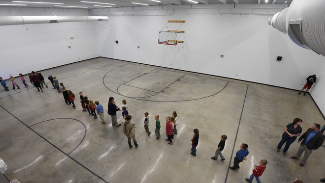 Flippin Elementary School students tour the school's new gymnasium Wednesday. The gymnasium will double as a shelter and was built to withstand winds of 250 mph. Winds of that speed are associated with an F5 tornado.