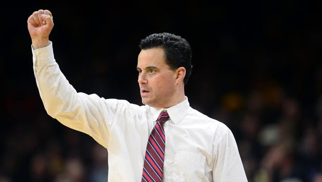Feb 24, 2016: Wildcats head coach Sean Miller calls in a play in the second half against the Colorado Buffaloes at the Coors Events Center. The Buffaloes defeated the Wildcats 75-72.