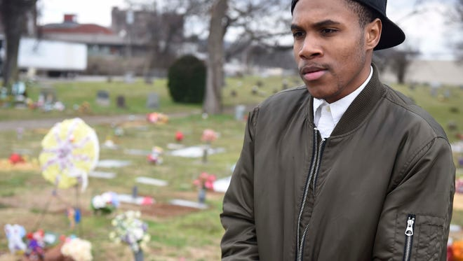 """Lamontae Burleson talks at the resting place of his little sister, Treyonta, in Greenwood Cemetery on March 4. It was his first visit to her grave since she was killed in November. """"I kept saying, 'I'm going to come see you girl, but it's something I (haven't) been able to deal with it,"""" Burleson said. """"(There are) times when I want to break down for her, but I can't. She'd just want me to be strong."""""""