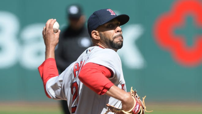 David Price struck out 10 and won his weather-delayed debut for Boston.