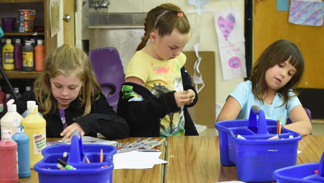 """Norfork elementary students work on art projects in this file photo. Norfork schools recently received money for being in the top 5 percent of schools based on student performance and earned a """"B"""" on the state's most recent report card."""