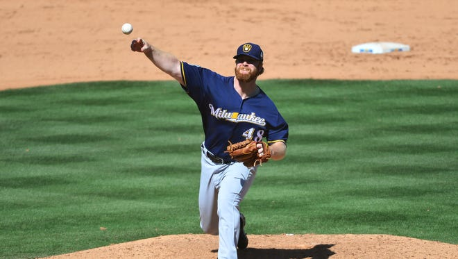 Milwaukee Brewers reliver Blaine Boyer pitches against the Chicago Cubs during spring training.