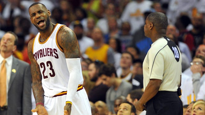 Cleveland Cavaliers forward LeBron James complains to referee Leroy Richardson during Game 1 against the Detroit Pistons on April 17, 2016.