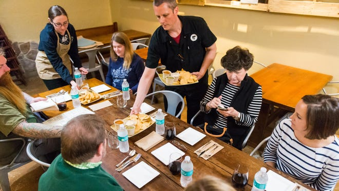 Culture head chef Travis Wright serves the new Mayan influenced menu to Golden Ticket winners at Culture in West Ocean City on Thursday, April 21.