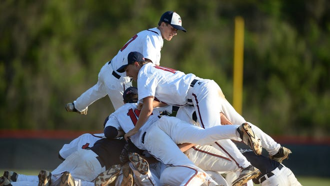 Powdersville players celebrate after the final out of their 5-3 win over Buford in the Class AA District I championship game Wednesday.