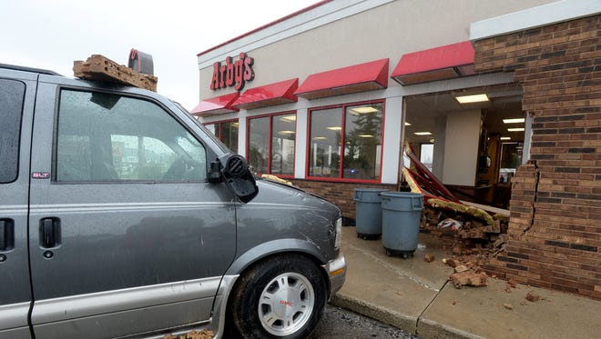The Arby's on Richmond's west side closed to inside customers Wednesday after a vehicle crashed into the building.