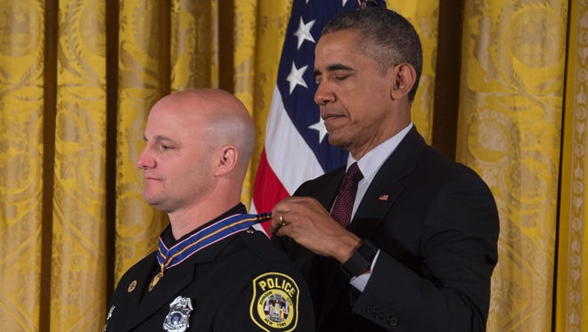 President Obama awards the Medal of Valor to Patrolman Louis Cioci, of Johnson City, N.Y., for pursuing and apprehending a gunman who had killed a fellow officer at a crowded hospital, thereby saving the lives of employees, patients, and visitors, during a ceremony at the White House Monday.