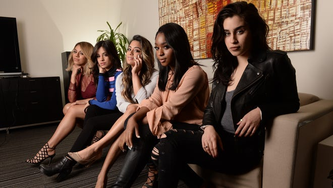"""Fifth Harmony members have the poses down for our USA TODAY shoot: (L-R)  Dinah Jane, Camila Cabello, Ally Brooke, Normani Kordei and Lauren Jauregui. The group has a hit single and video """"Working from Home"""" and an upcoming album release """"7/27"""". Photo by Robert Hanashiro, USA TODAY Staff    -- Video and photo shoot of the vocal group Fifth Harmony. They have a hit single and music video out 'Working from Home'. Portrait shoot of the group; photos and video of the group teach dance moves to USAT's Carly Mallenbaum.--     ORG XMIT:  RH 134835 Fifth Harmony da 04/28/2016 [Via MerlinFTP Drop]"""