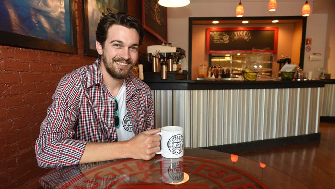 Patrick McGuire sits inside his soon to open coffee shop, Poughkeepsie Grind in the City of Poughkeepsie on Thursday.