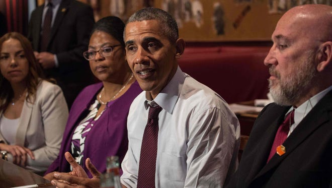 President Obama meets with formerly incarcerated individuals who have previously received commutations on March 30: From left to right: Serena Nunn, Ramona Brant, Obama and Phillip Emmert.