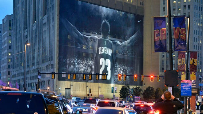 Traffic backs up outside of Quicken Loans Arena by the LeBron James mural.