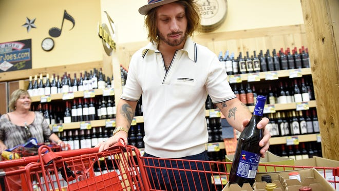 Melvin Lerhun shops for wine the first day of wine sales in grocery stores at Trader Joe's in Green Hills July 1, 2016 in Nashville, Tenn.