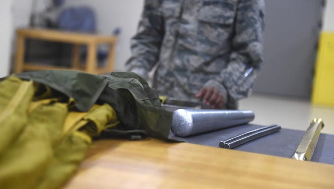 Airman 1st Class Dondrel, a 49th Operations Support Squadron aircrew flight equipment technician, places his packing tools near his work area at Holloman Air Force Base July 21. AFE specialists ensure that pilots are equipped with supplies for any situation. (Last names are being withheld due to operational requirements).
