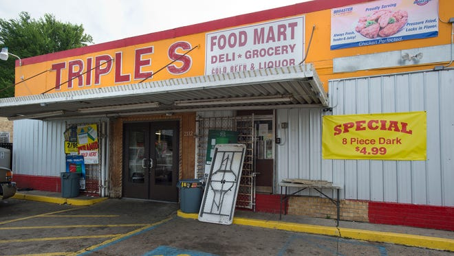 A man was fatally shot during an altercation with Baton Rouge Police at the Triple S Food Store on North Foster Drive in the early morning hours of Tuesday, July 5, 2016, in Baton Rouge, La. An autopsy shows Alton Sterling, 37, of Baton Rouge, died Tuesday of multiple gunshot wounds to the chest and back, said East Baton Rouge Parish Coroner Dr. William Clark. Officers responded to the store about 12:35 a.m. Tuesday after an anonymous caller indicated a man selling music CDs and wearing a red shirt threatened him with a gun, said Cpl. L'Jean McKneely. (Travis Spradling/The Advocate via AP)